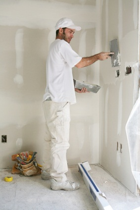 Drywall repair being performed by an experienced Zelaya Jr Painting drywall technician.