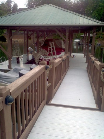 Freshly painted boat house and dock.