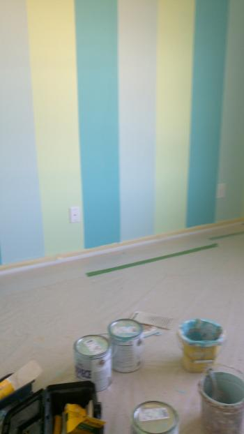 Couple selecting paint color for painters to begin painting their house.