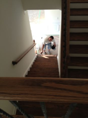 Wood Staining of the stairs in NC by Zelaya Jr Painting